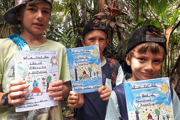 The Up in the Hill boys holding books that they made.