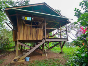 The outside view of the Pantai Cabin at the pantai cabin at the up in the hill eco lodge in Bocas del Toro Panama.