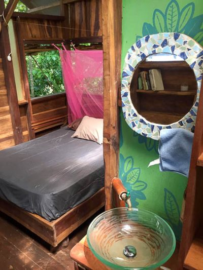 The bed with mosquito net at the Silverback Cabin on Isla Bastimentos.