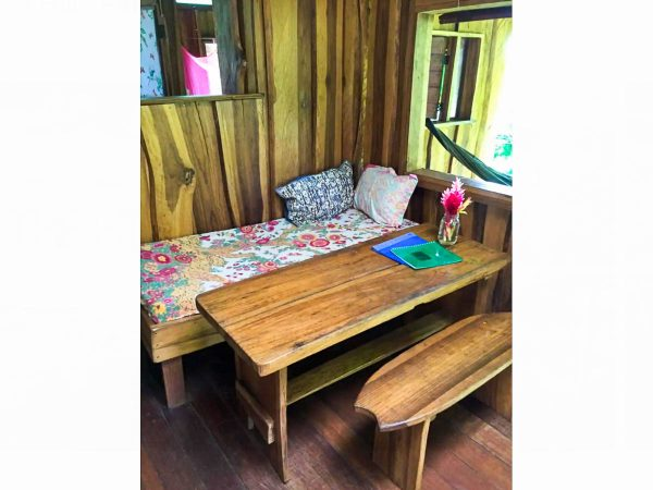 Inside dining area of the Pantai Cabin at Up in the Hill.