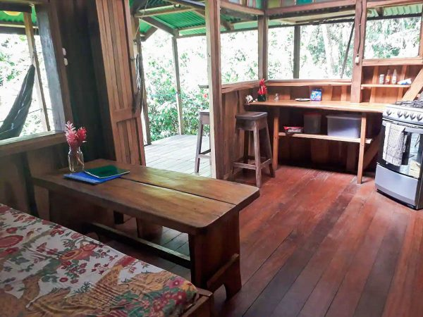 The kitchen and dining area of the Pantai Cabin