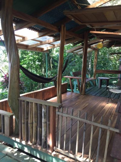 The outside deck of the up in the hill eco lodge in panama.